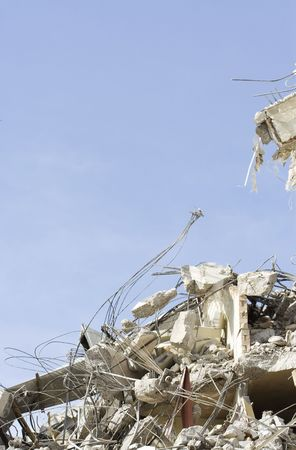 bombing: A close view of debris from a building demolition with plenty of room for copy