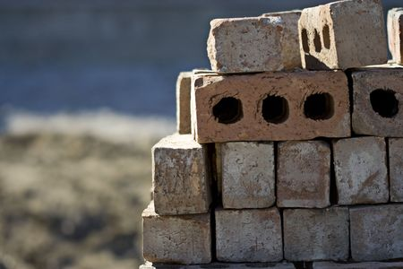 construction companies: A pile of bricks ready to be used to build a home. Great background for bricklayer or construction companies.