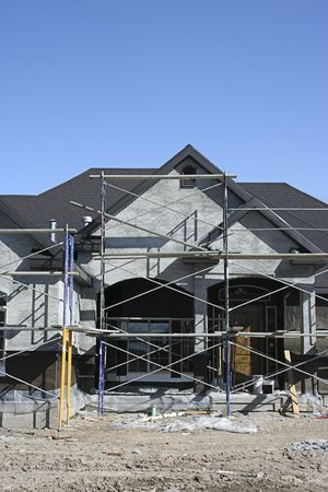 property development: A new home under construction with scaffolding covering the front of the home