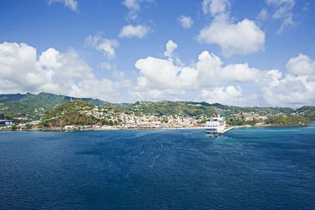 docked: The island of Grenada in the Caribbean. This scenic little port village is St. Georges in the lush green spice islands. Notice the cruise ship docked.