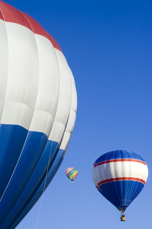 Colorful Hot air balloons of various degrees of proximity on a bright blue shiny day Reklamní fotografie