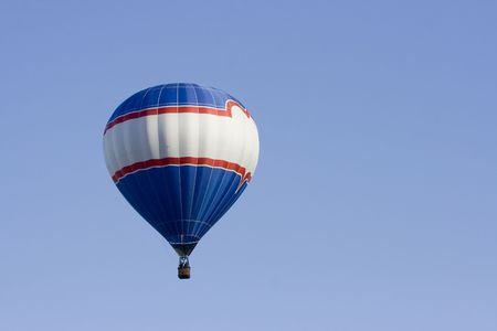 A Colorful Hot air balloon drifts through the sky on a warm summer morning. Lots of copy space in the blue sky Stock Photo - 3245992
