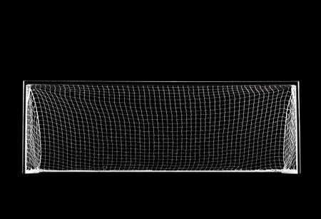 soccer pitch: A soccer goal or football goal with a simple black backdrop isolated from the darkness with spotlight lighting Stock Photo