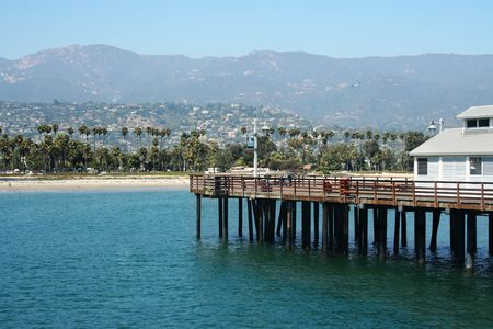 A view of Santa Barbara California from the pier looking back at the beach city and foothills photo