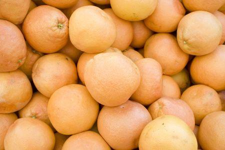 A pile of fresh Grapefruit photo
