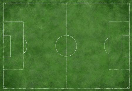 Een getextureerd gras voetbal of voetbal veld met grens markeringen Stockfoto