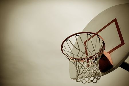 cross processed: A horizontal cross processed basketball hoop background. Lots of Copy space room and cool sepia filter feel. Stock Photo
