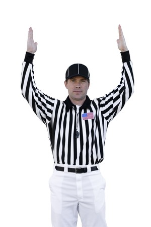 exhibiting: A football referee signals for a touchdown. Stock Photo