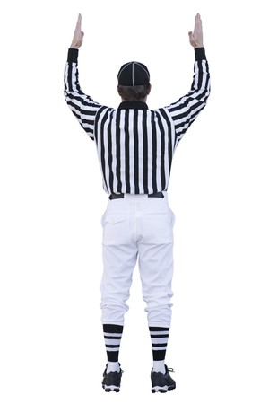 A football referee signals for a touchdown. This image is isolated on a white background