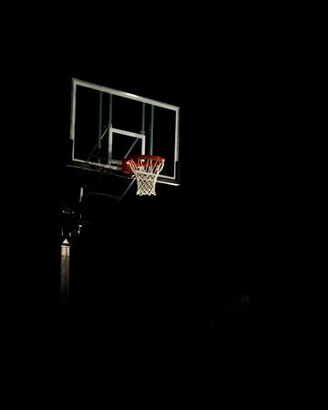 hoops: Basketball Basket in a black background Stock Photo