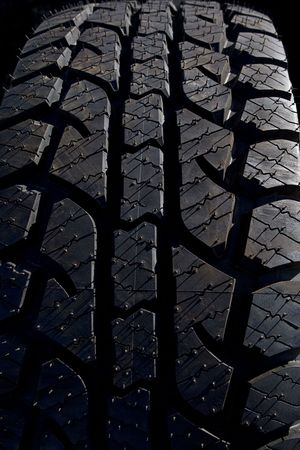 traction: The sharp contrast and detail of the treads and grooves of a rubber tire