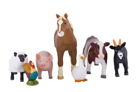 A collection of plastic farm animal toys isolated on a white background. (Sheep, rooster, pig, horse, goose, cow, goat)