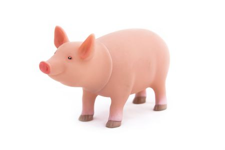 reproduction animal: A plastic pink pig toy isolated on a white background Stock Photo