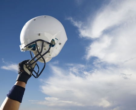 Football Helmet Raised in Victory 스톡 콘텐츠