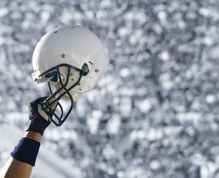 Football Helmet at Stadium Stock Photo