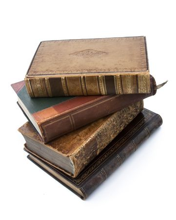 stacked books: Antique old books