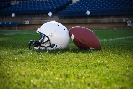 american football field: Football Helmet and ball Stock Photo
