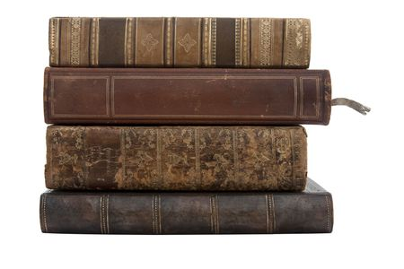 stack of old antique books isolated on a white background photo