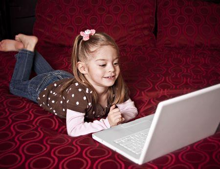 laptop: Child using a laptop computer