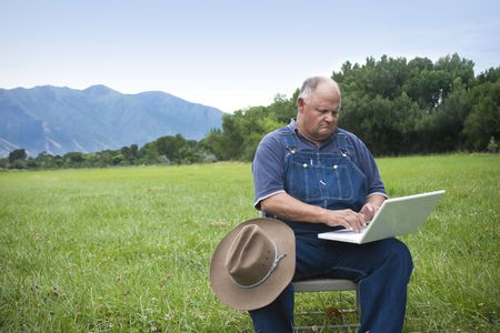 Old Farmer Adapting to the computer age  photo