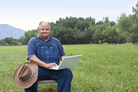 farmer's: Senior Man using laptop computer