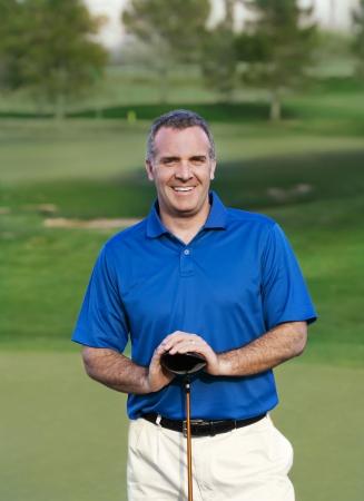 enjoyable: Smiling Mature Golfer on golf course  Stock Photo