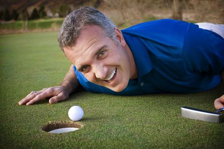 Male Golfer missing the putt photo