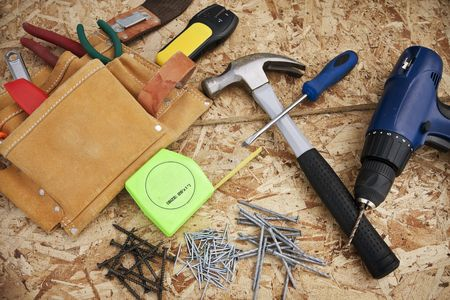 Assorted tools resting on particle board ready for construction photo
