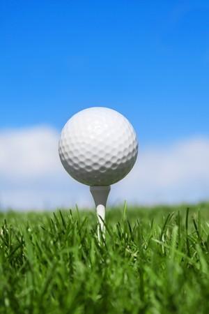 Golf Ball on a tee vertical