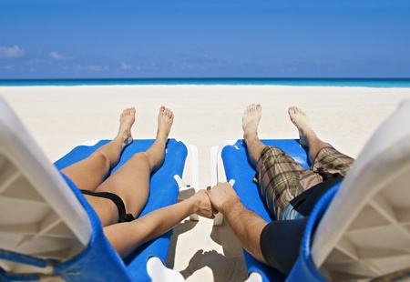 Couple enjoying Peace, love and tranquility on a secluded beach photo