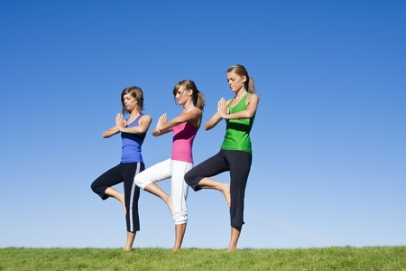 Women doing morning Yoga and Exercise photo