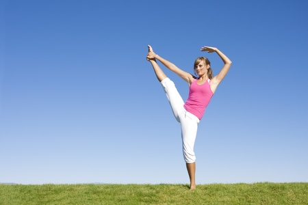 limber: Beautiful Woman doing Fitness and Yoga Stock Photo