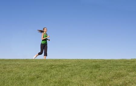 Female Jogger on the horizon photo