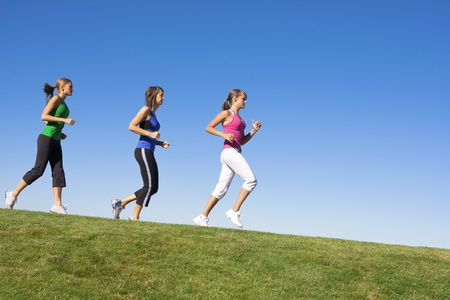 Female Joggers running downhill Stock Photo - 8510427