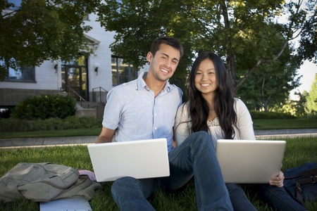 Beautiful College Students Studying together photo