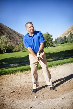 Mature Male Golfer on the golf course photo