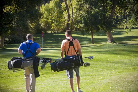 Golfers walking on the Golf Course photo
