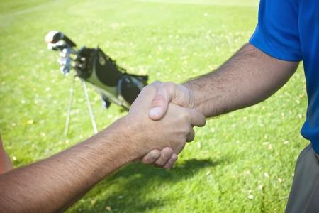 Golfers Shaking Hands Zdjęcie Seryjne