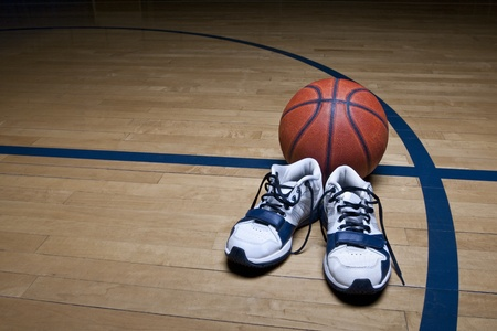 gym shoes: Basketball Court with ball and sneakers Stock Photo