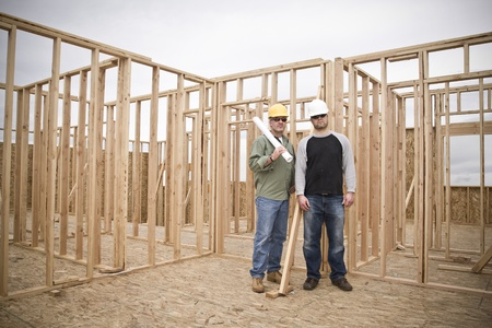 unfinished building: Building Contractors on a job site Wide Angle