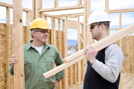 supervise: Construction Workers on the job building a home Stock Photo