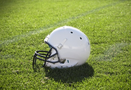 Football helmet on the playing field photo