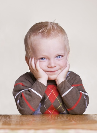 Cute little boy portrait with bored expression Stock Photo - 9784143