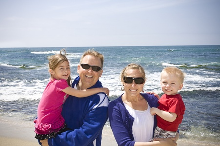 Happy Young Family at the Beach Stock Photo - 9784147