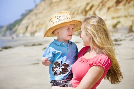 Child and Mother play at the beach together Stock Photo - 9784153
