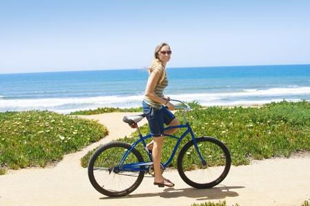 beach cruiser: Woman on a Bicycle Ride along the beach