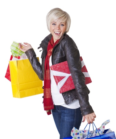 A beautiful female Happily shopping. Isolated on a white background Stock Photo - 9785328