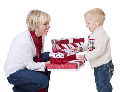 Beautiful woman Giving Christmas Presents to a Child photo