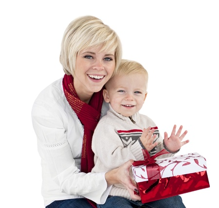 Beautiful woman Opening Christmas Presents with child Stock Photo - 9785326
