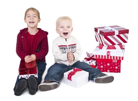 Excited Children opening their Christmas Gifts Stock Photo - 9785327